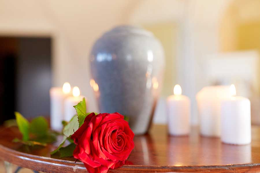 Humanist funeral ceremonies - photo of red rose beside an urn